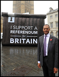 Adam Afriyie MP poses for a photograph in front of a Ballot box with a I Support A  Referendum for Britain slogan on it in Westminster, London, United Kingdom. Wednesday, 6th November 2013. Picture by Andrew Parsons / i-Images