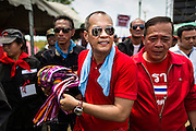 06 APRIL 2014 - BANGKOK, THAILAND: NATTAWUT SAIKUA, a Red Shirt core leader, is greeted by supporters as he walks through the crowd at a Red Shirt rally in a Bangkok suburb Sunday. Red Shirts and supporters of the government of Yingluck Shinawatra, the Prime Minister of Thailand, gathered in a suburb of Bangkok this weekend to show support for the government. The Thai government is dealing with ongoing protests led by anti-government activists. Legal challenges filed by critics of the government could bring the government down as soon as the end of April. The Red Shirt rally this weekend was to show support for the government, which public opinion polls show still has the support of most of the electorate.   PHOTO BY JACK KURTZ