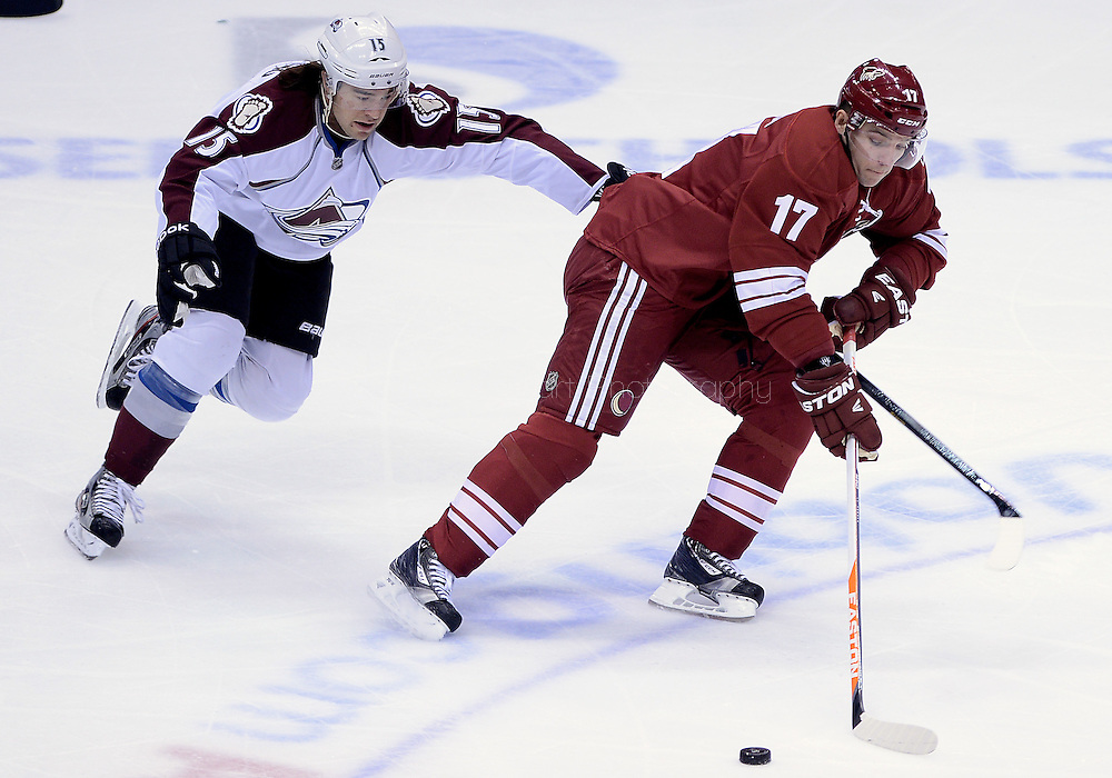 Apr. 6, 2013; Glendale, AZ, USA;  Phoenix Coyotes right wing Radim Vrbata (17) handles the puck in the first period against the Colorado Avalanche right wing P.A. Parenteau (15) at Jobing.com Arena. Mandatory Credit: Jennifer Stewart-USA TODAY Sports