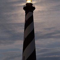 Full moon above top of the Cape Hatteras Lighthouse. Cape Hatteras National Seashore, NC