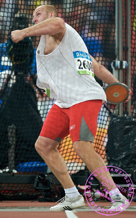 PIOTR MALACHOWSKI (POLAND) COMPETES IN THE MEN'S DISCUS THROW DURING THE BEIJING 2008 SUMMMER OLYMPIC GAMES IN BEIJING, CHINA.. .CHINA , BEIJING , AUGUST 19, 2008..( PHOTO BY ADAM NURKIEWICZ / MEDIASPORT )..PICTURE ALSO AVAIBLE IN RAW OR TIFF FORMAT ON SPECIAL REQUEST.