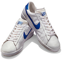 White and blue Nike shoes on white background