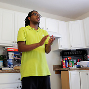 Homeowner Christian Pierce thanks friends, family, and Cape Fear Habitat for Humanity volunteers Sunday June 22, 2014 during a Cape Fear Habitat for Humanity dedication ceremony of a recently completed home on Tiffany Drive in Wilmington, N.C. (Jason A. Frizzelle)