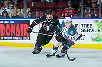 KELOWNA, CANADA - FEBRUARY 14:  Conner Bruggen-Cate #20 of the Kelowna Rockets back checks Alexander Alexeyev #4 of the Red Deer Rebels on February 14, 2018 at Prospera Place in Kelowna, British Columbia, Canada.  (Photo by Marissa Baecker/Shoot the Breeze)  *** Local Caption ***
