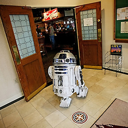 Kyle Green | The Roanoke Times<br /> March 01, 2009 - Controlled by Greg Tracy, from Maryland, (off camera), a R2D2 unit exits EJ's Lounge sports bar inside of the  Holiday Inn in Roanoke, Virginia during the 17th annual SheVaCon science fiction and fantasy convention. The R2D2 unit was at the convention as part of the R2DC, which is a gathering of fans who are in various stages in their pursuit to build an accurate replica of Star Wars most loved character: R2-D2.