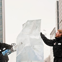 London, UK - 11 January 2012: Niall Magee and Pedro Mira at the Doubles Competition during the Ice sculpting festival 2013 in Canary Warf.