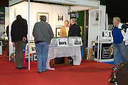 RIAC Classic Car Show 2013, RDS, Irish Photo Archive stand with manager Sean Walsh. Lensmen Press and Public Relations Photographic Agency was set up in 1952. The sixty years of Irish history captured there includes many fascinating images of key events: Rolling Stones, The Beatles, Princess Grace, Muhammad Ali and John F. Kennedy all visited, many Presidents were inaugurated and many Football and Hurling finals were won and lost. Irish, Photo, Archive.