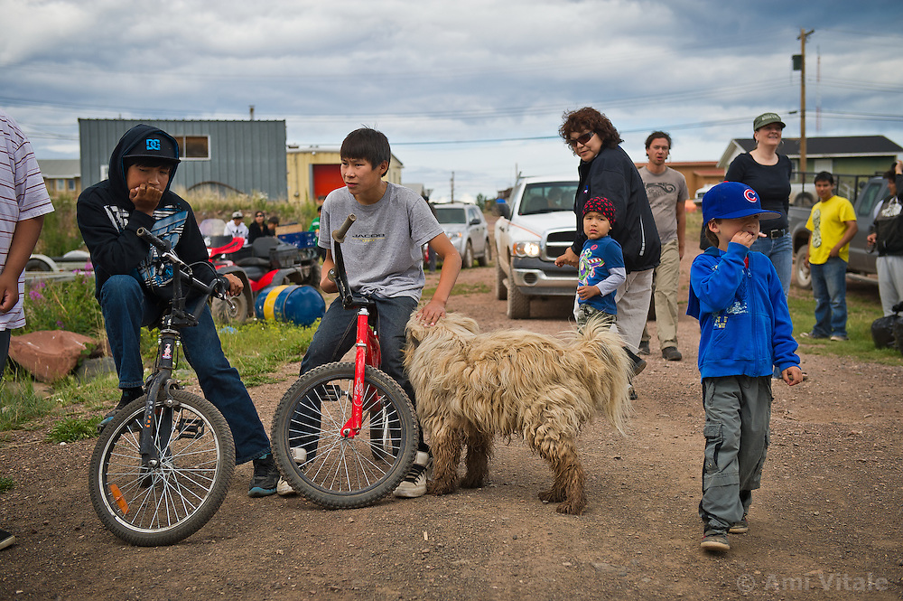 Villagers from the Dene' First Nation watch as Dene First Nation youth get on a float plane and leave their village of Lutsel K'e (aka Snowdrift) on their way to the Thelon Sanctuary  July 22, 2011 in the Northwest Territories of Canada.