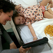 Holly Larue Frizzelle, 2 plays with her mother Leilani in her room at UNC Hospital in December 2012. On December 27, 2012 two year old Holly Larue Frizzelle was diagnosed with Acute Lymphoblastic Leukemia. What began as a stomach ache and visit to her regular pediatrician led to a hospital admission, transport to the University of North Carolina Children's Hospital, and more than two years of treatment.
