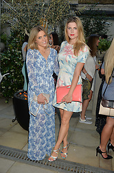 Left to right, OLIVIA COX and ASHLEY JAMES at a party to celebrate the launch of Le Jardin de Monsieur Li by Hermes in association with Mr Fogg's was held at Hermes, 155 New Bond Street, London on 9th July 2015.