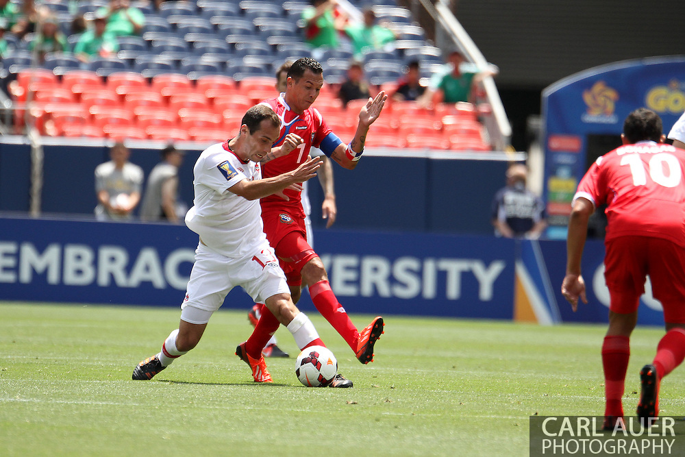 July 14 2013:  Canada Midfield Pedro Pacheco (13) and Panama Forward Blas Perez (7) during the CONCACAF Gold Cup soccer match between Panama and Canada at Sports Authority Field in Denver, CO. USA.