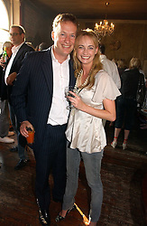 ORLANDO FRASER and CLEMENTINE HAMBRO at a party to celebrate the publication of Title Deeds by Liza Campbell at the First Floor, 186 Portobello Road, London on 14th June 2006.<br />