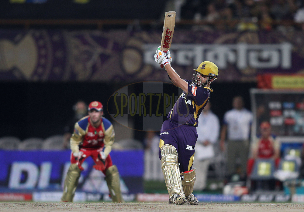 Kolkata Knight Riders captain Gautam Gambhir hits over the top for a boundary during match 38 of the the Indian Premier League (IPL) 2012  between The Kolkata Knight Riders and The Royal Challengers Bangalore held at the Eden Gardens Stadium in Kolkata on the 28th April 2012..Photo by Shaun Roy/IPL/SPORTZPICS