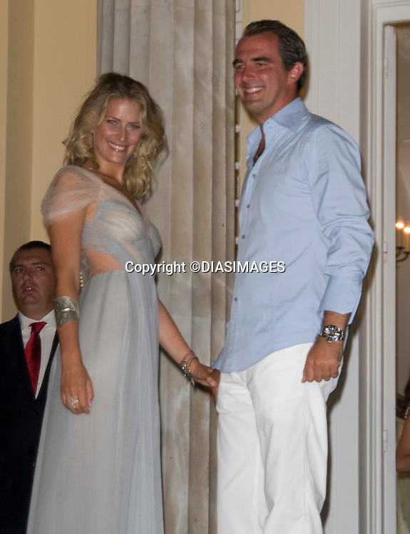 """PRINCE NIKOLAOS AND TATIANA BLATNIK_.at the cocktail party hosted by his parents King Constantine and  Queen Anne Marie at the Poseidonion Grace Hotel, Spetses_24/08/2010.Mandatory Credit Photo: ©DIASIMAGES..**ALL FEES PAYABLE TO: """"NEWSPIX INTERNATIONAL""""**..IMMEDIATE CONFIRMATION OF USAGE REQUIRED:.Newspix International, 31 Chinnery Hill, Bishop's Stortford, ENGLAND CM23 3PS.Tel:+441279 324672; Fax: +441279656877.e-mail: info@newspixinternational.co.uk"""