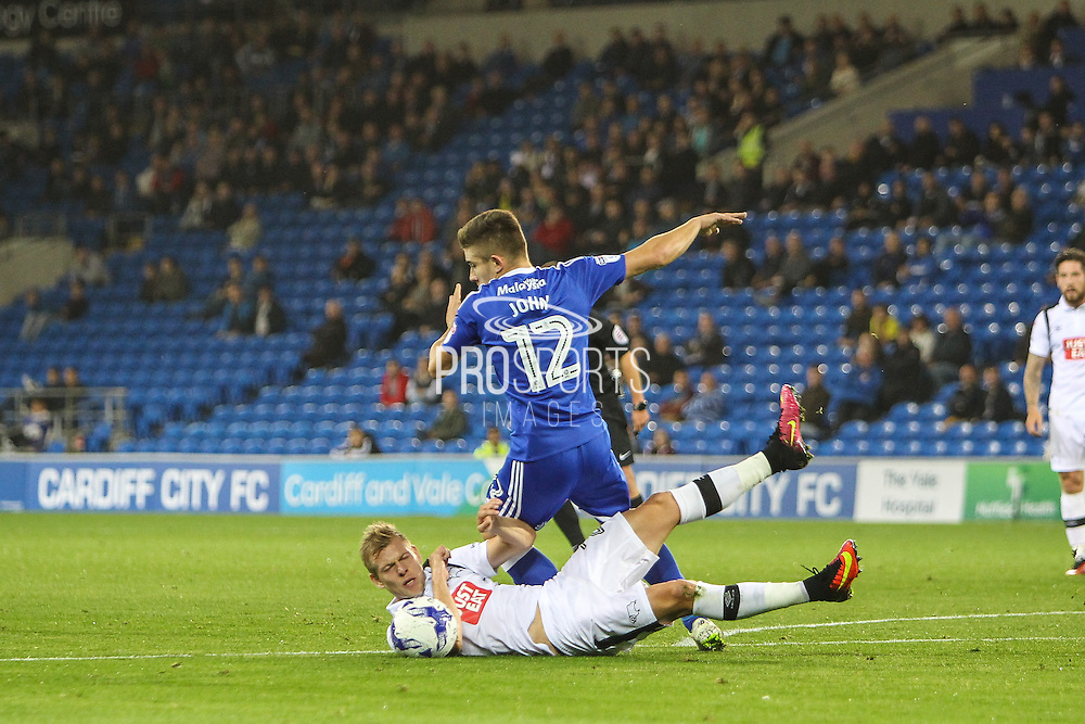 Matej Vydra of Derby County tackles Declan John of Cardiff City during the EFL Sky Bet Championship match between Cardiff City and Derby County at the Cardiff City Stadium, Cardiff, Wales on 27 September 2016. Photo by Andrew Lewis.