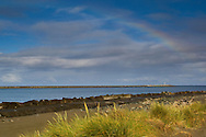 Rainbow over north and south jetties along the Entrance channel into Humboldt Bay, California