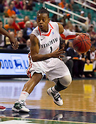 Miami senior Riquna Williams finished with 22 points and 6 assist as the Hurricanes held of NC State 93 - 85 in the quarterfinals of the 2011 ACC Women's Basketball Tournament held at the Greensboro Coliseum in Greensboro, North Carolina.  (Photo by Mark W. Sutton)