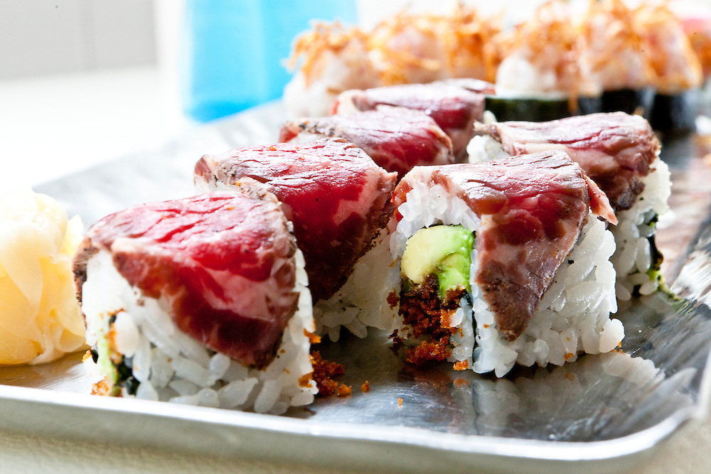 Kobe beef rolls lead a sushi assortment.
