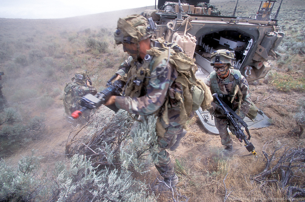 PFC Timothy Reed, followed by Sargent Lawrence Durero, of A Company, 5th Battalion, 20th Infantry dismount from their Stryker medium weight armored vehicle during exercises at the Yakima Training Center in Washington on Thursday June 27, 2002. Alpha Company is the first to receive the $2.5 million Stryker which is the Army's first new armored vehicle in 14 years. It is meant to fill the gap between light infantry that uses only Humvees for transport and heavy armor like the M1 Abrahams tank. ..Able to withstand heavy machine gun rounds but not anti-tank rounds or rocket propelled grenades the Stryker's key assets are rapid transport of its nine man squad overland or by the main in-theater cargo plane, the C-130. The Stryker is also using the FBCB2 computer system allowing each vehicle to know friendly and enemy positions, real-time battlefield intelligence, email, gps mapping, and feeds from remote surveilance aircraft. It is also equiped with a .50 caliber machine gun or grenade launcher with video and thermal imaging operated remotely from within the vehicle...According to Army personel, if the battalion had been ready it would have been one of the first units into Afghanistan. As it is, it will represent the Army's new medium weight brigades in the Millenium Challenge excercises at Ft. Irwin, California, in late July. The live and computer simulated excercise will test the U.S. Military's concept for working together.
