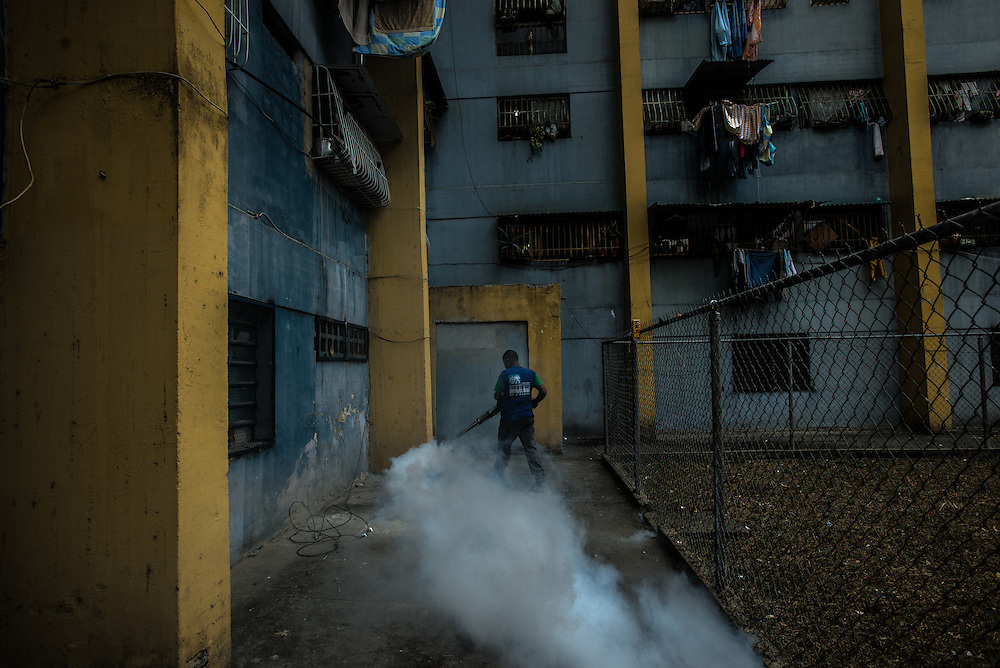 CARACAS, VENEZUELA - MARCH 19, 2016: A government worker fumigates a residential building for mosquitos, as part of efforts to control the Zika virus in Venezuela.   <br /> PHOTO: Meridith Kohut for IRIN News