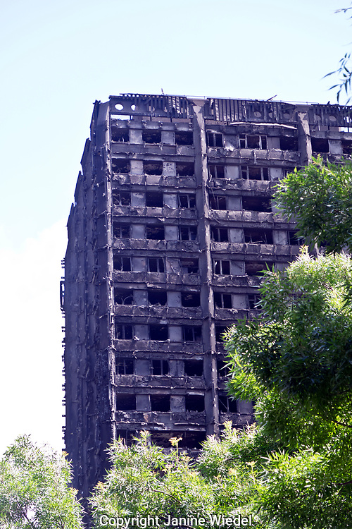 The community of Latimer Road in the aftermath of the fire that destroyed the 24-story Grenfell Tower in North Kensington, London on 14th June 2017.  The death toll officially at 75 but will no doubt rise to three figures.