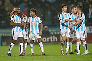 Team mates celebrate with goal scorer Mustapha Carayol (Huddersfield Town) during the Sky Bet Championship match between Huddersfield Town and Rotherham United at the John Smiths Stadium, Huddersfield, England on 15 December 2015. Photo by Mark P Doherty.