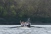 London, Great Britain, Oxford raise their arms after surcuring the first The Newton Women's Boat Race, win, Championship Course.  River Thames. Putney to Mortlake. ENGLAND. <br /> <br /> 17:09:35  Saturday  11/04/2015<br /> <br /> [Mandatory Credit; Peter Spurrier/Intersport-images]<br /> <br /> OUWBC Crew: <br /> Maxie SCHESKE, Anastasia CHITTY, Shelley PEARSON, Lauren KEDAR, Maddy BADCOTT, Emily REYNOLDS, Nadine GRAEDEL IBERG, Caryn DAVIES and Cox Jennifer EHR