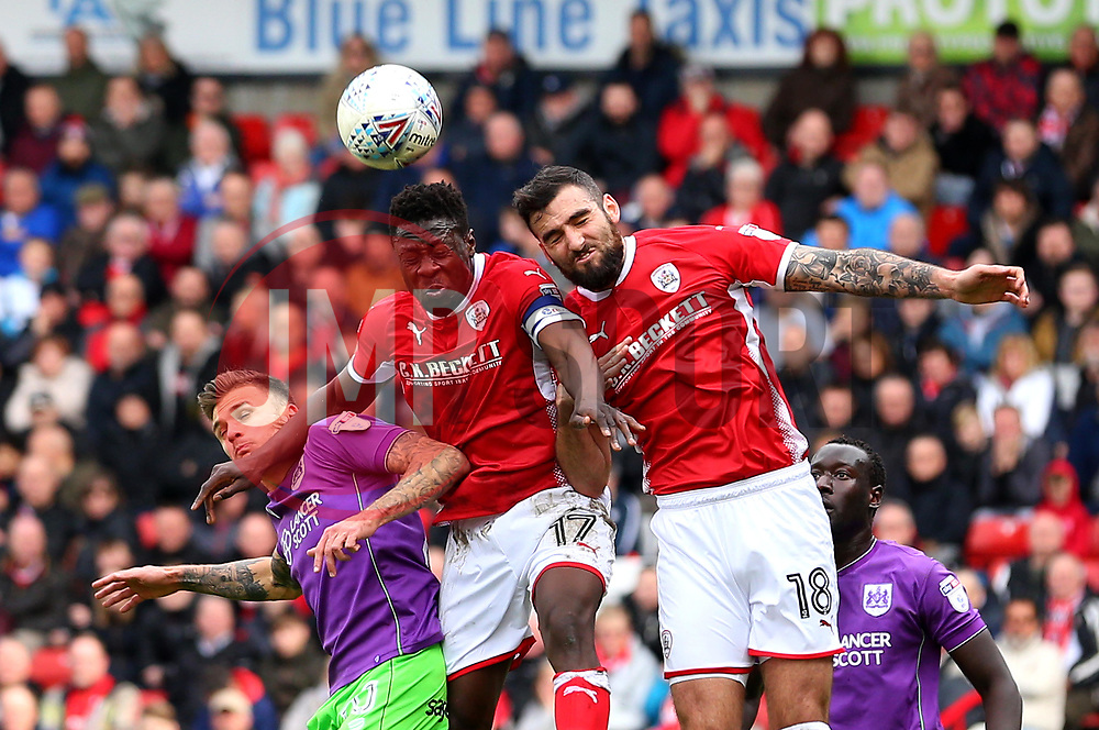 Jamie Paterson of Bristol City challenges Andy Yiadom and Adam Jackson of Barnsley - Mandatory by-line: Robbie Stephenson/JMP - 30/03/2018 - FOOTBALL - Oakwell Stadium - Barnsley, England - Barnsley v Bristol City - Sky Bet Championship