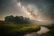 The night ushers in a haunting layer of fog in the distance as the Milky Way makes for a striking display above the country side surrounding Gandy Creek in West Virginia