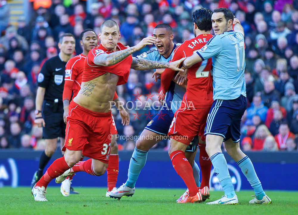 LIVERPOOL, ENGLAND - Saturday, January 31, 2015: Liverpool's Martin Skrtel has his shirt pulled in the penalty area against West Ham United during the Premier League match at Anfield. (Pic by David Rawcliffe/Propaganda)