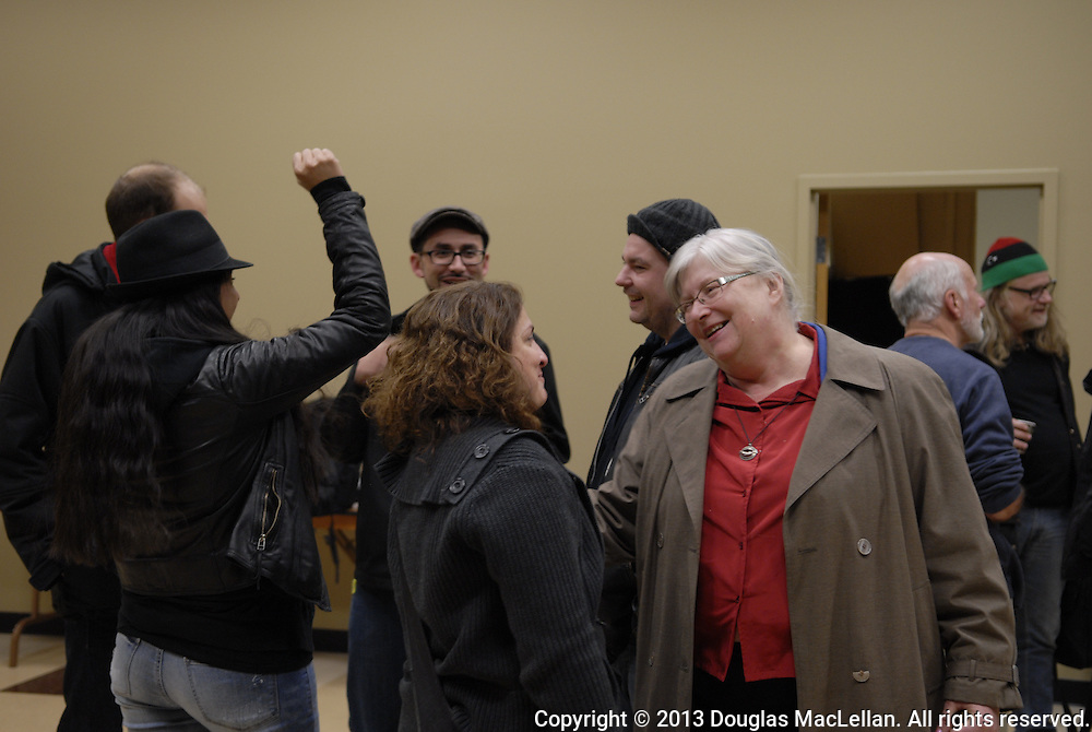 Victoria Cross (middle , red blouse) and others enjoy the social at the end of the Making Waves Windsor Essex Assembly on November 23, 2013 at Unifor local 195 Hall.