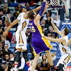 Nov 8, 2013; New Orleans, LA, USA;  Los Angeles Lakers center Pau Gasol (16) shoots over New Orleans Pelicans power forward Anthony Davis (23) during the first half of a game at New Orleans Arena. Mandatory Credit: Derick E. Hingle-USA TODAY Sports