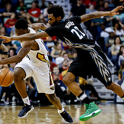 Mar 19, 2017; New Orleans, LA, USA; New Orleans Pelicans forward Solomon Hill (44) and Minnesota Timberwolves forward Andrew Wiggins (22) scramble for a loose ball during the second quarter of a game at the Smoothie King Center. Mandatory Credit: Derick E. Hingle-USA TODAY Sports