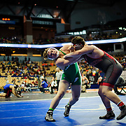 Kris Wilson/News Tribune<br /> Blair Oaks' Tanner Lueckenhoff, left, and Carrolton's Ethan Staton lock up in their opening round 220-pound match during the 2016 MSHSAA Wrestling State Championships at Mizzou Arena in Columbia.