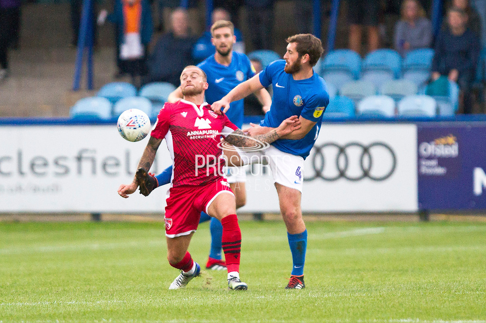 Macclesfield Town midfielder Jak McCourt tables the opponent during the EFL Sky Bet League 2 match between Macclesfield Town and Morecambe at Moss Rose, Macclesfield, United Kingdom on 20 August 2019.