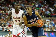 Trent Brinkley (4) of Dallas Kimball drives past Derrick Griffin (23) of Rosenberg Terry during the UIL 4A state championship game at the Frank Erwin Center in Austin on Saturday, March 9, 2013. (Cooper Neill/The Dallas Morning News)