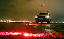Heathrow Airport, airside, airfield operations vehicle on taxiiway at night, March 2006, Ref CHE03098d, DP