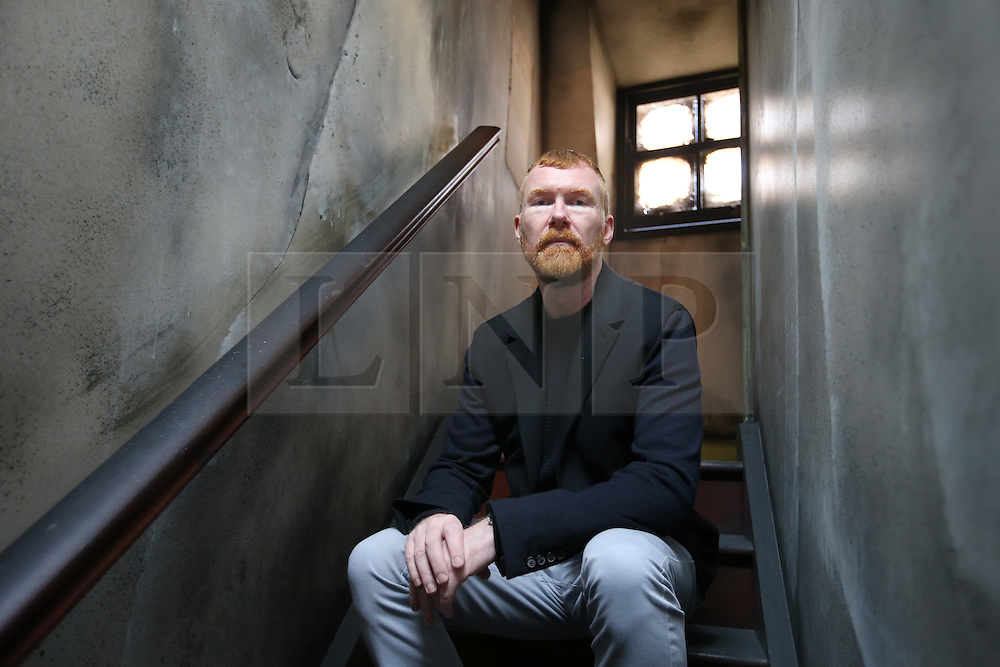 © Licensed to London News Pictures. 04/10/2015. London, UK. Mark Palmer-Edgecumbe, owner of the Jack the Ripper Museum, sits inside the museum after a planned protest was cancelled. Photo credit: Peter Macdiarmid/LNP