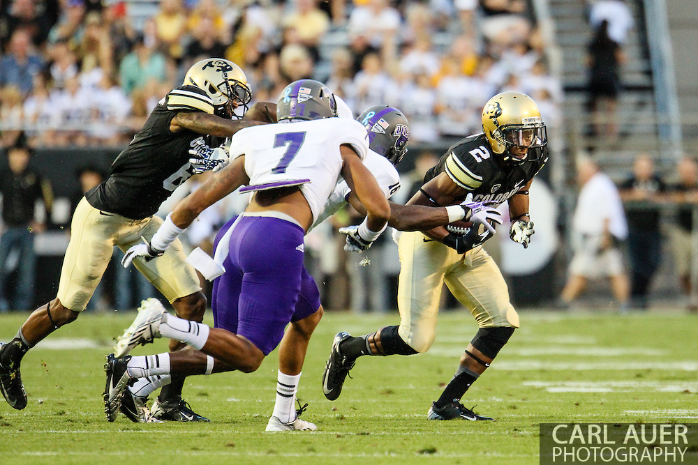 September 7th, 2013 - Colorado Buffaloes freshman wide receiver Devin Ross (2) attempts to bring the ball around the defense in the second quarter of the NCAA football game between the University of Central Arkansas Bears and the University of Colorado Buffaloes at Folsom Field in Boulder, CO
