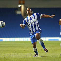 Brighton & Hove Albion's Chris O'Grady beats Cheltenham Town's Tony Brown to the ball during the English Capital One Cup 1st Round between Brighton & Hove Albion FC and Cheltenham Town FC at the American Express Community Stadium, Brighton, 12th August 2014 © Phil Duncan | SportPix.org.uk