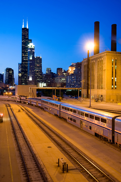 Putting together an outbound Amtrak long distance train, a switch crew works in the yard under Roosevelt Rd. and the Sears Tower.