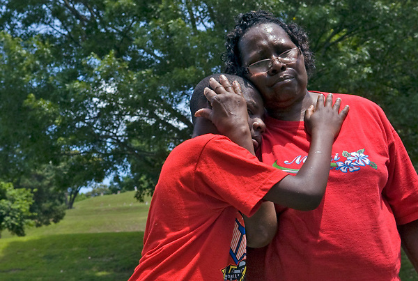 "Julius Branch, 11, comforts his grandmother Everlena Henderson Branch while visiting her father Ed Henderson's grave in the World War I Veteran section of the Vicksburg National Cemetery at the Vicksburg National Military Park on Memorial Day. ""I think about you every day,"" said Branch to her father."