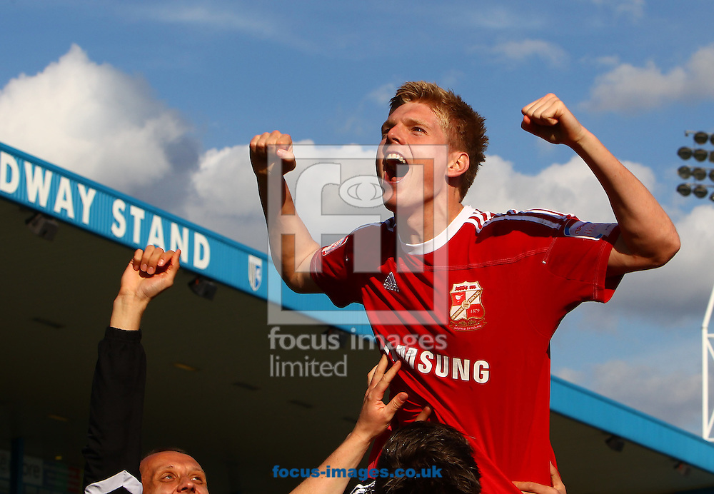 Picture by John Rainford/Focus Images Ltd. 07506 538356.21/04/12.Matt Ritchie of Swindon Town celebrates promotion after the Npower League 2 match at Priestfield Stadium, Gillingham