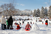 People snow sledding  in Central Park  on January 27, 2011 in New York City.<br />