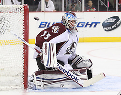 Mar 15; Newark, NJ, USA; Colorado Avalanche goalie Jean-Sebastien Giguere (35) makes a save during the second period of their game against the New Jersey Devils at the Prudential Center.