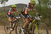 Sally Bigham (right) and Ester Suss (left) under pressure to catch Team RECM 2 during stage 4 of the 2014 Absa Cape Epic Mountain Bike stage race from The Oaks Estate in Greyton, South Africa on the 27 March 2014<br /> <br /> Photo by Greg Beadle/Cape Epic/SPORTZPICS