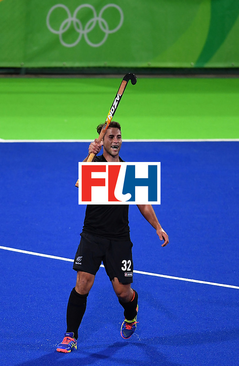 New Zealand's Nick Wilson celebrates scoring a goal during the mens's field hockey Belgium vs New Zealand match of the Rio 2016 Olympics Games at the Olympic Hockey Centre in Rio de Janeiro on August, 12 2016. / AFP / MANAN VATSYAYANA        (Photo credit should read MANAN VATSYAYANA/AFP/Getty Images)