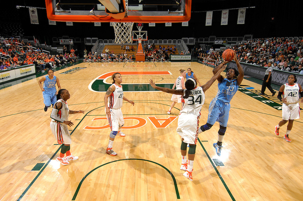 February 8, 2012: Laura Broomfield #33 of North Carolina shoots over Sylvia Bullock #34 of Miami during the NCAA basketball game between the Miami Hurricanes and the North Carolina Tar Heels at the Bank United Center in Coral Gables, FL. The Hurricanes defeated the Tar Heels 61-37.