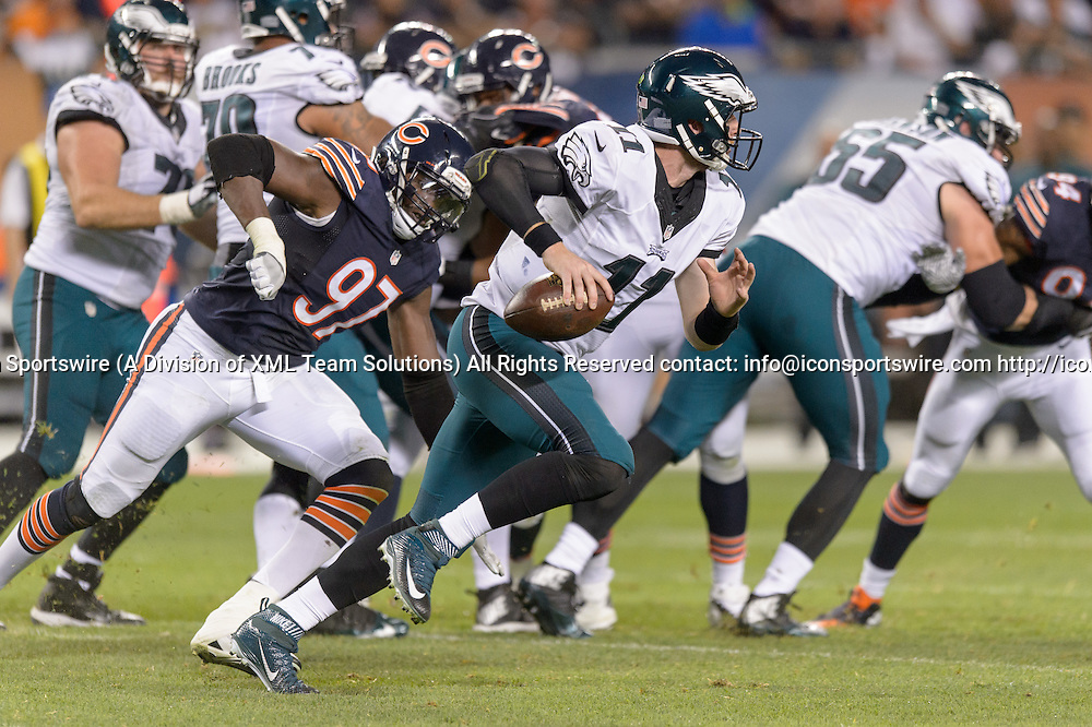 19 September 2016: Philadelphia Eagles Quarterback Carson Wentz (11) [21352] runs with the ball while Chicago Bears Linebacker Willie Young (97) [9864] pursues during an NFL football game between the Philadelphia Eagles and the Chicago Bears at Solider Field in Chicago, IL. The Philadelphia Eagles won 29-14. (Photo by Daniel Bartel/Icon Sportswire)