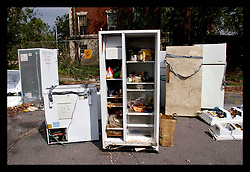 9th Oct, 2005. Hurricane Katrina aftermath, New Orleans, Louisiana. Refridgerators line the sidewalks and streets of the Uptown neighbourhoods as residents return and throw away the fetid, stinking appliances. Many are taped shut to prevent them from opening. Someone has written, 'Voodoo here today now 5,' on many of the appliances.